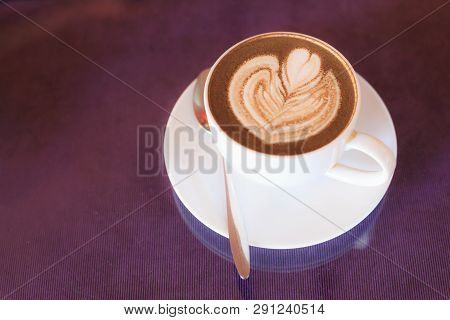 Hot Cappuccino Coffee Decorated With Blooming Flower Froth Art On Steamed Milk Foam In White Cup On