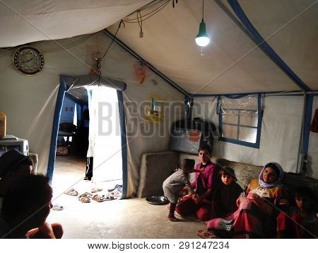 22.05.2017, Sheikhan Camp, Iraq.: Yazidi Family Inside A Refugee Tent In Northern Iraq Close To Moss