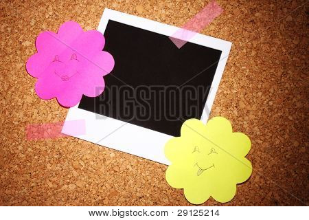 Photo paper with colored paper in the shape of a flower on ?ork background