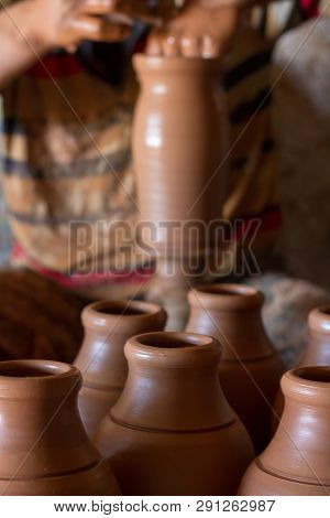 Ceramic Workshop - The Man  Makes A Pot Of Clay On A Potter's Wheel
