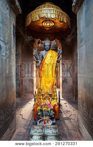 God Vishnu Statue At Angkor Wat Temple In Siem Reap In Cambodia. Angkor Wat Is The Largest Temple In