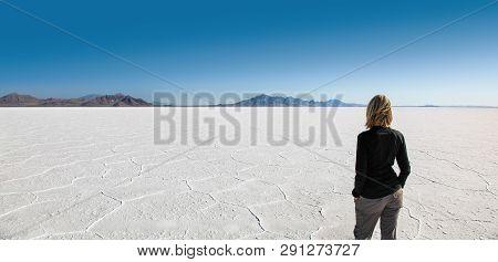 Lone Woman Enjoying Stark Beauty Of The Bonneville Salt Flats