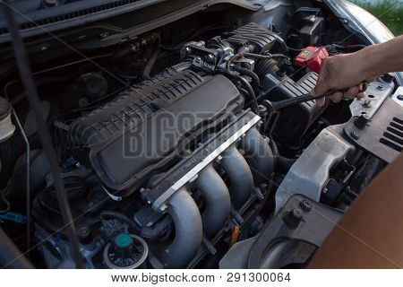 Mechanic, Technician Man Holding Spanner Checking Car Engine. Car Service, Repair, Fixing, Checking