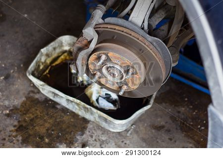 Replacement Old Car Disc Brakes, Close Up. Disc Brake On Car In Process Replacement New Tire. Auto M