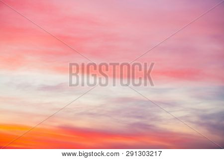 Sunset Sky With Pink Orange Light Clouds. Colorful Smooth Blue Sky Gradient. Natural Background Of S