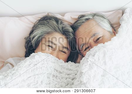 Happy Love Elderly Couple Smiling , Senior Couple Old Man And Senior Woman Relaxing In Bed Room - Li