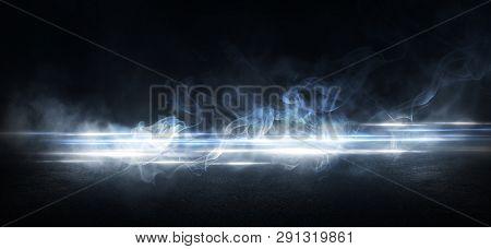 Wet Asphalt, Reflection Of Neon Lights, A Searchlight, Smoke. Abstract Light In A Dark Empty Street