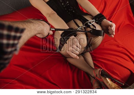 Adult Sex Games. Submissive Girl In Bondage And Man's Hand With Spanking Prepare For Punishment.