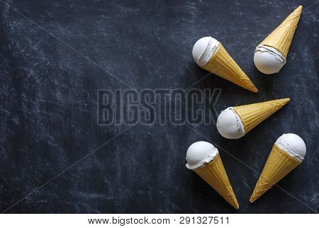 Five Cones With Creamy Italian Ice Cream Dessert Arranged As A Side Border On A Textured Grey Backgr