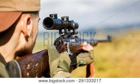Hunter Is Aiming. Shooter Sighting In The Target. Hunter Man. Hunting Period. Male With A Gun. Close