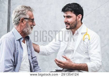 Senior Patient Visits Doctor At The Hospital.