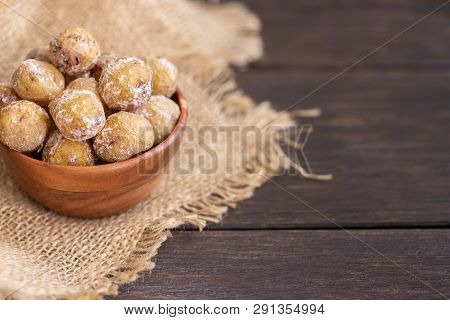 Popular Canary Islands dish, Papas Arrugadas (wrinkly potatoes)  on wooden background, copy sapace poster