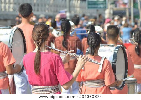 Young Girl Wear Thai Traditional Suit Playing Flute For Show In Marching Band Paraded On Street With