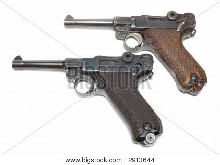 Two Guns Isolated Over A White Background