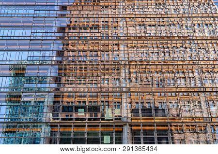 Mirroring Skyscraper In The Windows Of A Skyscraper