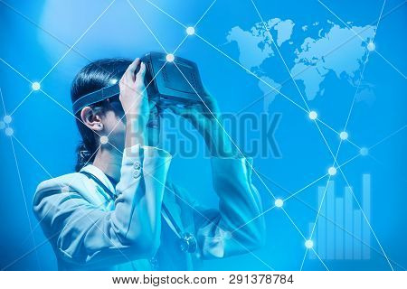 Asian Female Doctor Looking At Digital Interface With Virtual Reality Device Display The World Map A