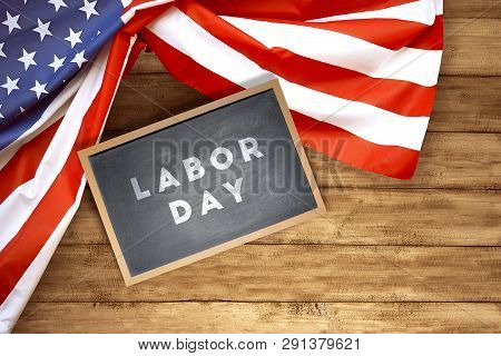 Little Blackboard With Labor Day Text And American Flag On Wooden Background. Labor Day Concept