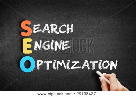 Color Wooden Alphabets Building The Word Seo - Search Engine Optimization Acronym On Blackboard