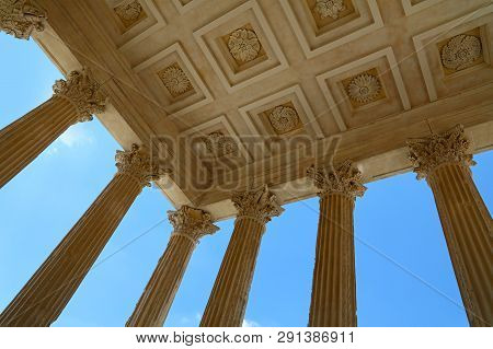 Low angle view of ceiling and Corinthian columns of Maison Carree (square house), ancient building in Nimes, Provence, southern France poster