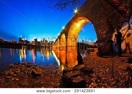 Minneapolis - October 27: A View Of The Beautiful Stone Arch Bridge Of Minneapolis, Mn, Usa At Dusk,