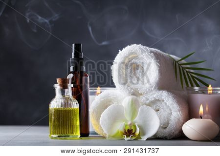 Aromatherapy, Spa, Beauty Treatment And Wellness Background With Massage Oil, Orchid Flowers, Towels