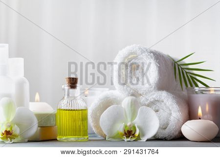 Spa, Beauty Treatment And Wellness Background With Massage Oil, Orchid Flowers, Towels, Cosmetic Pro