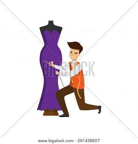 Tailor Standing On One Knee Hemming Purple Dress On Mannequin