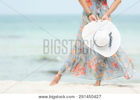 Summer Holiday. Close Up Hand Holding Big White Hat.  Lifestyle Woman Wearing Fashion Summer Trips S