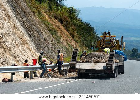 Jamaica - February 19 2019: Wrecker being used to transport rubble from landslide/ rockfall on North South Highway/ Edward Seaga Highway in Jamaica