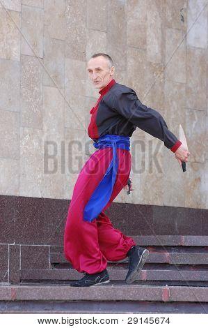 KIEV, UKRAINE - JUNE 6: Dancer wearing historical costume. Annual festival of traditional Ukrainian music. Kiev,Ukraine. June 6, 2009