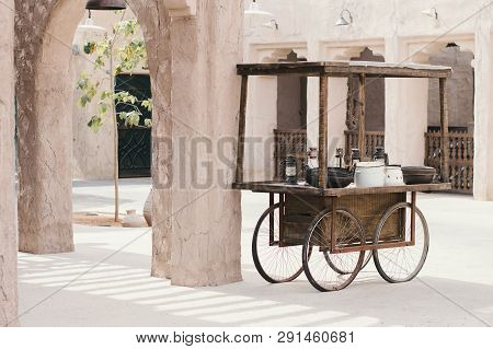 Uae, Dubai - January, 2019: Wooden Trolley With Crockery And Lanterns At The Market In Al Seef Prome