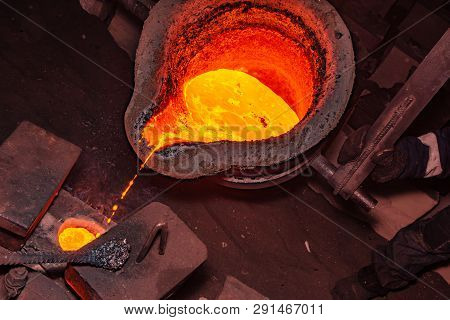 metal casting process with red high temperature fire in metal part factory poster