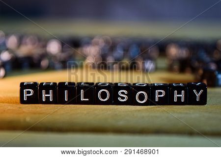 Philosophy Concept Wooden Blocks On The Table. With Personal Development, Education And Motivation C