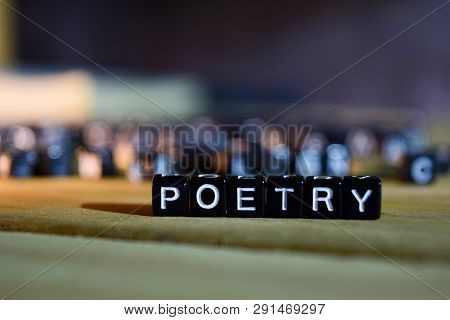 Poetry Concept Wooden Blocks On The Table. With Personal Development, Education And Motivation Conce