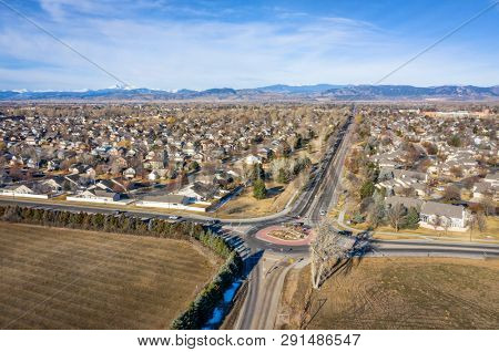 typical residential neighborhood and roundabout along Front Range of Rocky Mountains in Colorado, aerial view of Fort Collins