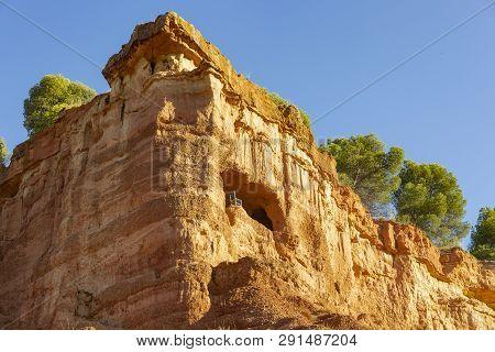A Cave With A Chair In The Mountain - Escarpment Above Anento Village, Province Of Zaragoza, Aragon,