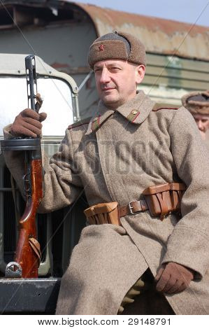 Man wears historical Soviet uniform as he participates in a WWII reenactment