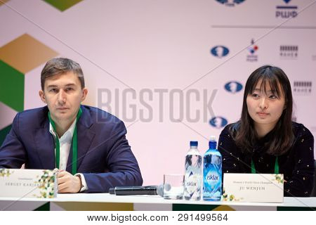 ST. PETERSBURG, RUSSIA - DECEMBER 25, 2018: World Chess Champion Ju Wenjun, China (right) and Vice-Champion Sergey Karjakin, Russia on the press conference dedicated to World Rapid&Blitz Chess Champ