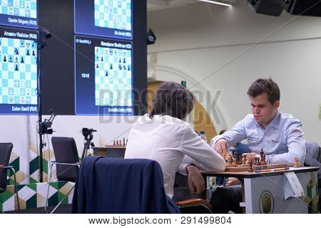ST. PETERSBURG, RUSSIA - DECEMBER 28, 2018: World Chess Champion Magnus Carlsen, Norway (right) vs Grigoriy Oparin, Russia during King Salman World Rapid Chess Championship 2018. Carlsen won the match