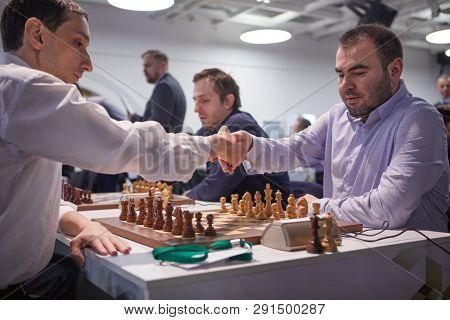 ST. PETERSBURG, RUSSIA - DECEMBER 29, 2018: Grandmaster Shakhriyar Mamedyarov, Azerbaijan (right) handshakes with Robert Hovhannisyan, Armenia before the match of World Blitz Chess Championship 2018
