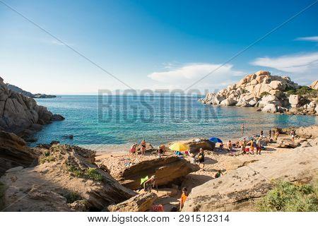 Cala Spinosa Beach. Capo Testa, Sardinia, Italy - July 9, 2018: Cala Spinosa Beach with Tourists. Capo Testa, Sardinia Island, Italy. Sardinia is the Second Largest Island in Mediterranean Sea.