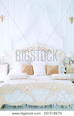Luxury Bedroom Interior Design In White And Beige Colors With Tulle Baldachin Over The Bed, Plasterw