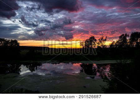 Beautiful Lilac Sunset Over The River, Pink And Lilac Clouds
