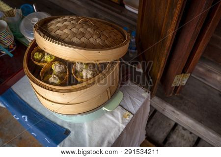 Chinese Steamed Dumpling (dim Sum Siu Mai) In The Streamer Pot, Appetizer Of Chinese Food Tradition