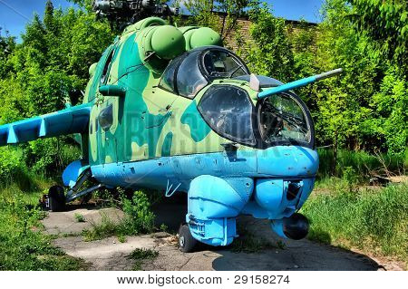 HDR. Old Soviet military helicopter MI-24 with bullet prints on glass from Afganistan poster