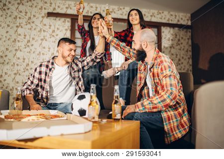Football fans wathing tv broadcast at home