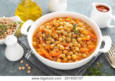 Chana Masala, Spicy Chickpea Curry With Carrot And Onion In Tomato Sauce. Vegetarian Dish For Lunch.