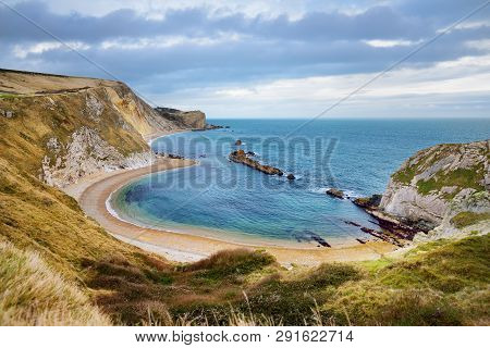 Man O'war Cove On The Dorset Coast In Southern England, Between The Headlands Of Durdle Door To The