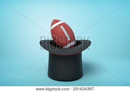 3d Rendering Of Black Tophat Upside Down With Brown Gridiron Football Inside On Light Blue Backgroun