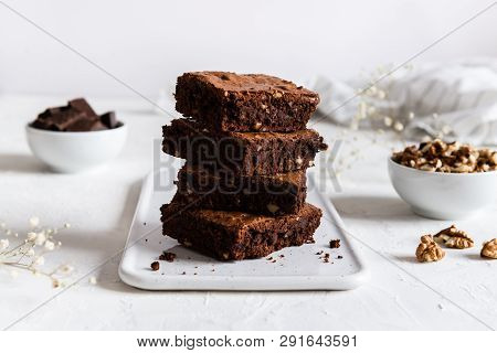 Homemade Dark Chocolate Brownies On White Table. Delicious Bitter Sweet And Fudge. Chocolate Cake, S